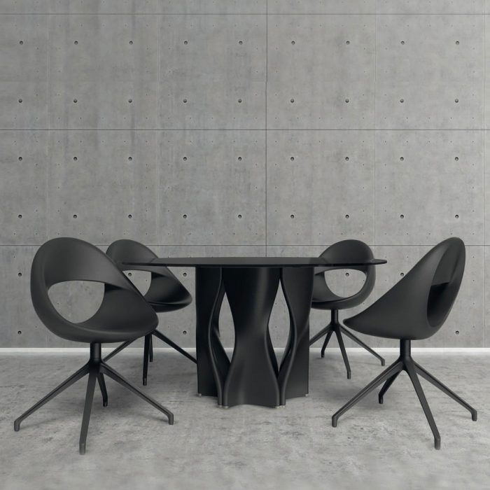 large glass table with black base