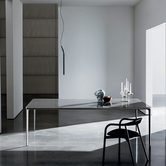 slim rectangular metal and glass dining table