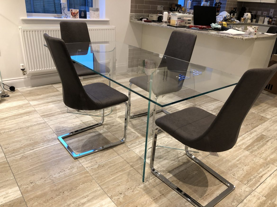 Curved Glass base Dining Table